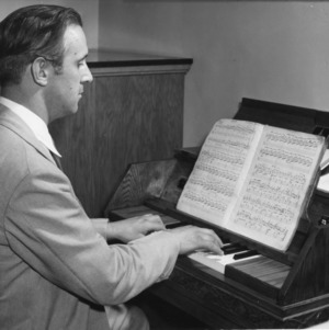 Professor Arthur L. Bigelow, bellmaster of Princeton University, performing inaugural recital at the dedication ceremony for the Memorial Tower carillonic bells, North Carolina State College, June 6, 1947.