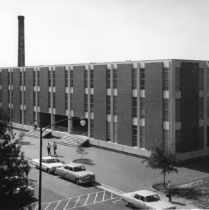 Mann Hall with smokestack in background, North Carolina State College