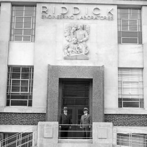 Chancellor John Harrelson and Dean John H. Lampe in front of the main entrance to newly constructed Riddick Engineering Laboratories