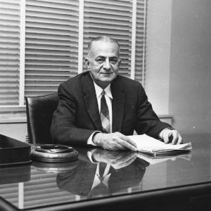 A. S. Brower sitting at desk in office