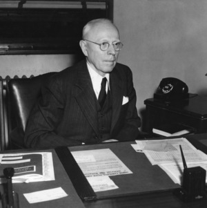 Dean Benjamin F. Brown at desk