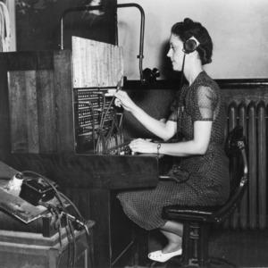 Mrs. Allen L. Baker, chief telephone operator at North Carolina State College