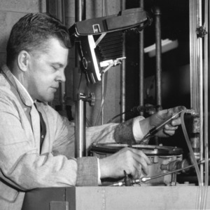 Dr. Kenneth O. Beatty working with engineering machinery