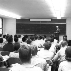 Chancellor Carey H. Bostian standing at blackboard in front of a class
