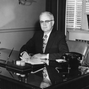 Carey H. Bostian sitting at his desk