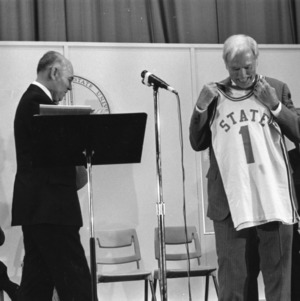 Chancellor John T. Caldwell receiving basketball jersey at his retirement ceremony