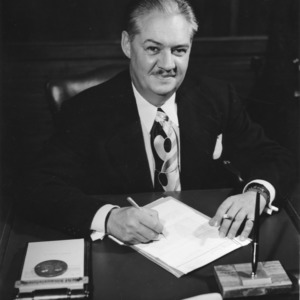 Dean Malcolm E. Campbell at desk