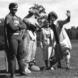 Former Raleigh Mayor Isabella Cannon posing with people dressed as Superman, Chuck E. Cheese, and Ronald McDonald