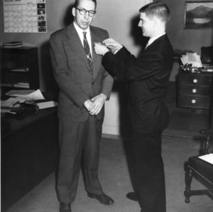 Dr. Robert G. Carson Jr. receiving Blue Key honor from Edward W. Nuckolls