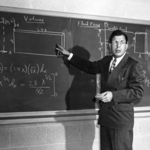 Dr. John W. Cell teaching at chalkboard