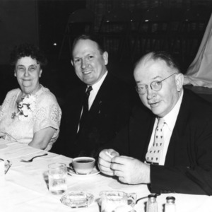E. L. Cloyd at table with two others