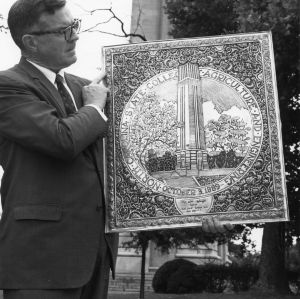 Dean of Faculty Harry C. Kelly with silver-washed copper plaque featuring the NC State Memorial Tower