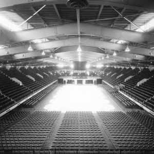 Interior view of newly constructed Reynolds Coliseum, looking from end of arena down at floor converted to ice skating rink.