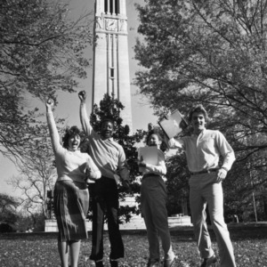 Students jumping in front of Memorial Bell Tower