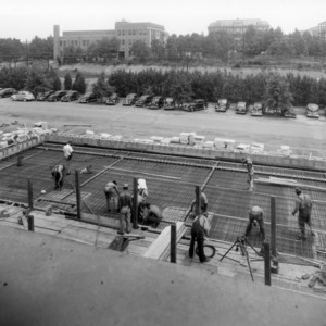 Construction work on roof of Reynolds Coliseum, June 23, 1949.