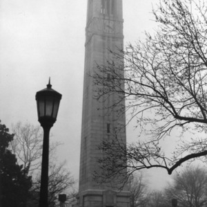 Memorial Tower with lamppost in foreground, North Carolina State College