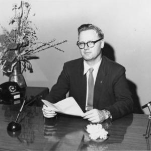 Gerald O. T. Erdahl at desk