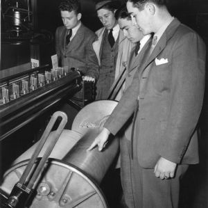 Student William C. Friday and others in a textile laboratory