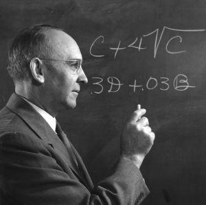 C. Horace Hamilton writing on blackboard