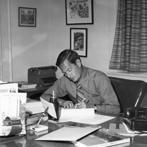 Joseph S. Hancock, assistant director of publications for Information Services at North Carolina State University, working in his office.