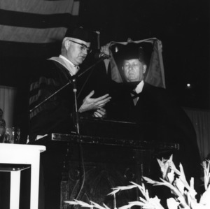 John W. Harrelson receiving honorary degree from Chancellor C. H. Bostian at commencement