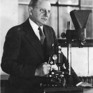 Charles M. Heck with scientific apparatus