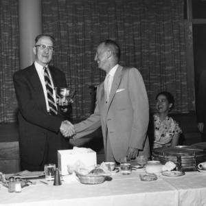 Christian D. Kutschinski receiving award from Dean of Student Affairs James J. Stewart