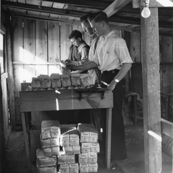 Rudolph Ellis (in front) and two other 4-H club members packing peanuts.