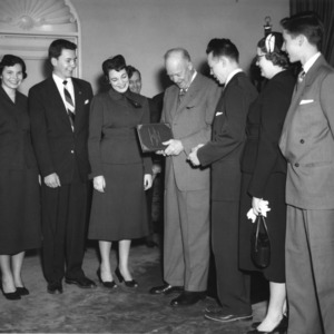 President Eisenhower receiving a copy of the 4-H Report to the Nation, April 17, 1953