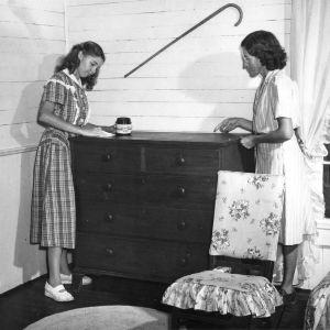 Hazel Sempkin, Wake County, North Carolina, 4-H club member, refinishing furniture with her mother.