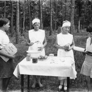 4-H girls preserving fruits and vegetables