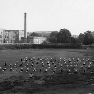 North Carolina 4-H Leader L. R. Harrill leading an early morning class in physical training on the athletic field at Riddick Stadium during the sixth annual State 4-H Short Course at North Carolina State College, July 5-10, 1926.