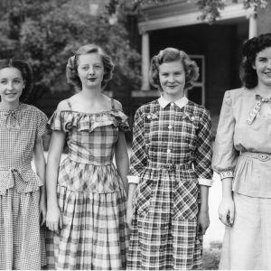 Group portrait of four 4-H Dress Revue participants.