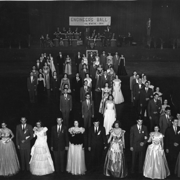 1948-1949 Engineers' Council members and their dates in the figure during the annual Engineers' Ball held in Memorial Auditorium