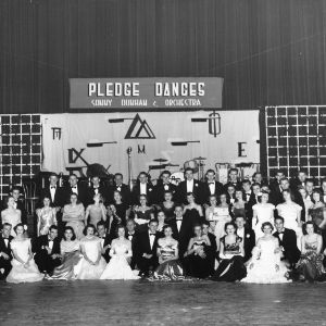 Group portrait of men and women at North Carolina State College fraternity pledge dance featuring Sonny Dunham and his Orchestra.