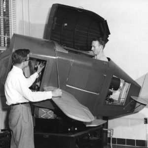 School of Engineering students checking the operation of a ground aviation trainer for pilots