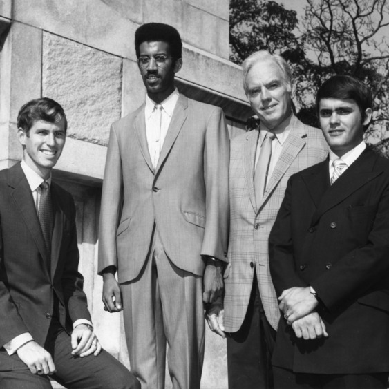 Chancellor John T. Caldwell posing with North Carolina State University student government officials at Memorial Bell Tower