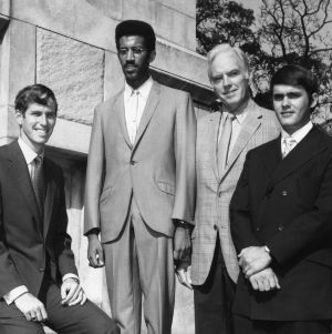 Chancellor John T. Caldwell posing with North Carolina State University student government officials, including Eric N. Moore, at Memorial Bell Tower