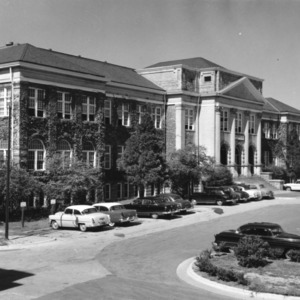 View of Patterson Hall showing automobiles in front parking lot, North Carolina State College