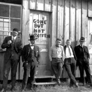 Men standing in front of the Shacks