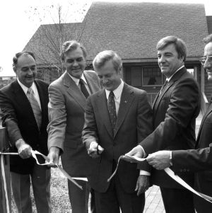 Governor James Hunt cutting the ribbon at a Solar House dedication