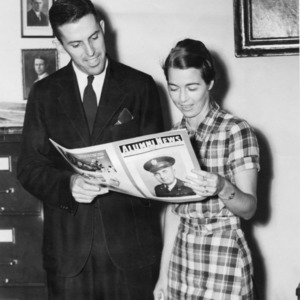 NC State College Alumni Association's Dan M. Paul and Nancy H. Steele posing with an issue of Alumni News, 1939
