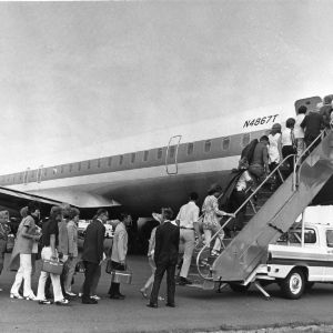Group boarding plane for NCSU Alumni Association sponsored trip to Europe