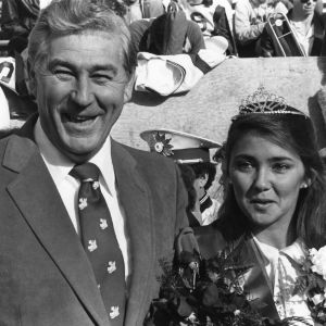 Chancellor Bruce Poulton posing with North Carolina State University 1984-1985 homecoming queen Melody Speck.
