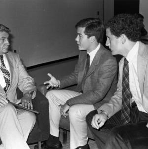 Student Body President Jim Yocum and Student Senate President Jeff Baker talk with Chancellor Poulton