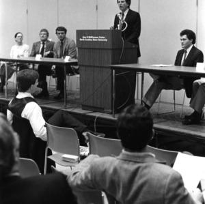 Speaker at podium in Jane S. McKimmon Center