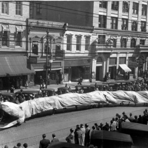 Engineering students with snake float in 1930 Engineers Fair, in honor of Saint Patrick