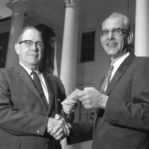 Carl R. Harris giving award to Textiles professor Ernest B. Berry