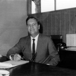 W. J. Bridges at desk