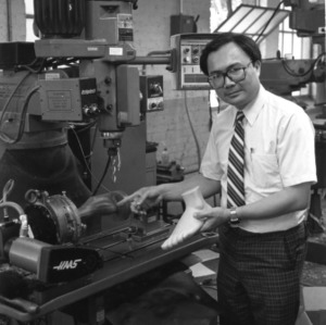 Dr. Han P. Bao demonstrating machining for orthopedic footwear